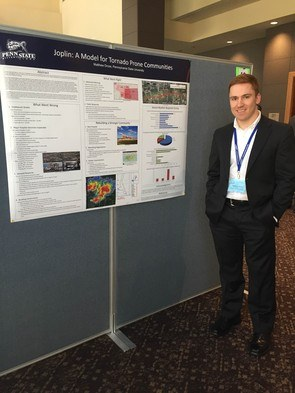 Matthew Dross in front of his poster at the NWA Conference.