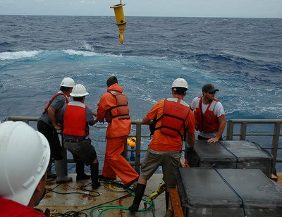 Penn State researchers Raymond Najjar (2nd from left) and Douglas Martins (4th from left) retrieve a drifter from the Atlantic Ocean with the help of the  ship's crew. Image: Bettina Sohst/Old Dominion University.